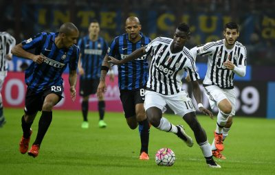 Juventus' midfielder from France Paul Pogba (R) fights for the ball with Inter Milan's defender from Brazil Joao Miranda during the Italian Serie A football match Inter Milan vs Juventus on October18, 2015 at the San Siro Stadium stadium in Milan. AFP PHOTO / OLIVIER MORIN